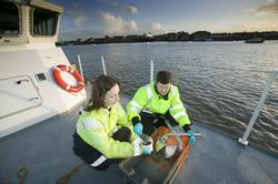 PLA staff taking silt samples for environmental analysis